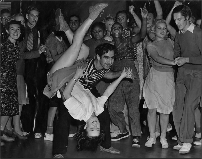 Teens 1950s Jitterbugging couple show off their footwork