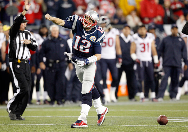 Tom Brady celebrates after running for a first down during the third quarter of Monday's Texans-Patriots game. Brady threw four touchdown passes as New England won in a route, 42-14. (AP Photo/Stephan Savoia)  BANKS: Patriots deliver message with dominating winGALLERY: Rare Photos of Tom Brady