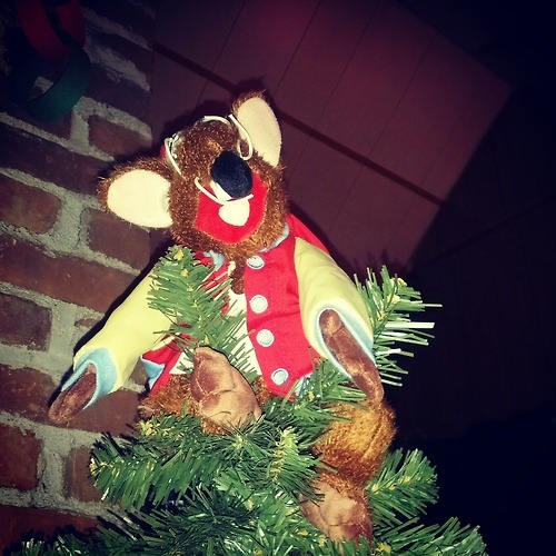 catholmes submitted to nevertoooldtolovemuppets:  I couldn't find a tree topper I wanted this year, so I stuck my Rizzo stuffed animal on top. He seems to like it up there.   Oh man! That's so awesome!