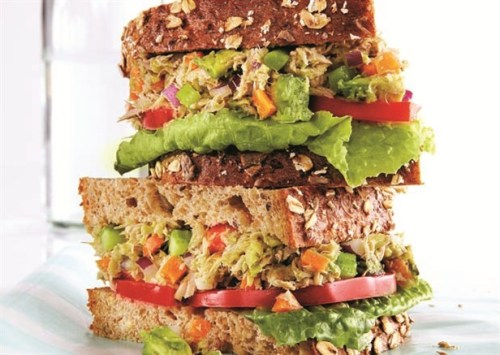 Power lunch! Omega-3s and healthy fats make this Tuna Avocado Sandwich a winning combination. TUNA AVOCADO SANDWICH Ready in 10 minutes • Makes 2 servingsIngredients: 2 5-oz cans water-packed white tuna  1 large ripe avocado ¼ cup each carrots, celery, red onion, diced Sea salt and pepper, to taste 2 slices whole-grain bread, cut in half For the nutritional info: http://bit.ly/ZwYvs4