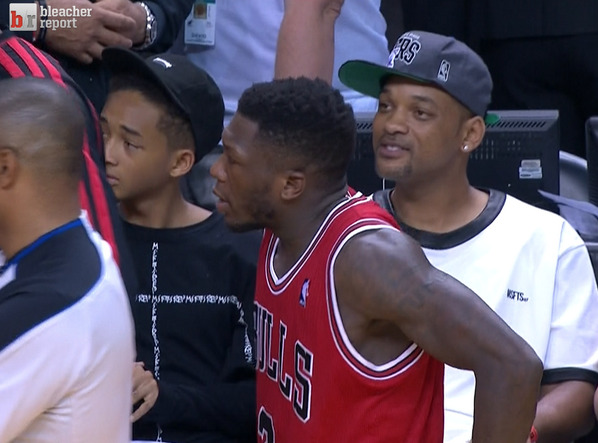 Jaden Smith - Will and Jaden Smith sitting by the Bulls bench in Miami