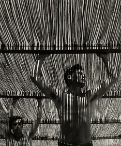 3wings:  Young Man Under Reed Roof, Torremolinos, 1951Herbert List