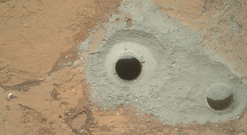 A banner day for the Mars rover Curiosity, as it conducted its first drilling beneath the surface layer of a martian rock today. The hope is to gain information about long-past, possibly wet environments on the red planet by taking samples from beneath its surface – in this case, 2.5 inches deep. The rock powder generated from the drilling was saved by the Curiosity, and will be analyzed by its highly sophisticated on-board laboratory. (Photo by  NASA/JPL-Caltech/MSSS) source