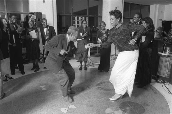 Writing legends Amiri Baraka and Maya Angelou dance in the atrium of the Schomburg Center.  Image via Vince Cush*te.