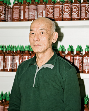 David Tran, creator of Huy Fong Foods Sriracha. The man behind the almighty rooster sauce stands in front of what I wish was my pantry. Businessweek writer Caleb Hannan got a rare glimpse into the story of Huy Fong Foods and the family behind it, while examining the cult status that surrounds their Sriracha. (And hey, look at that! I'm even quoted in the article!) Their success continues because of an unrelenting focus on quality and word of mouth alone. Huy Fong Foods has never advertised, has no official Facebook page or Twitter account, and their website hasn't been updated since May 2004. ALL HAIL DAVID TRAN. Read on for a fascinating look behind the curtain:Sriracha Hot Sauce Catches Fire, Yet 'There's Only One Rooster' - via Bloomberg Businessweek [Photograph by Nathanael Turner / Businessweek]