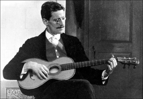 shakesphereanrag:  James Joyce plays the guitar, 1915. Though best-known for his formidable fiction, Joyce was a man of many lesser-known talents, including poetry and children's books.