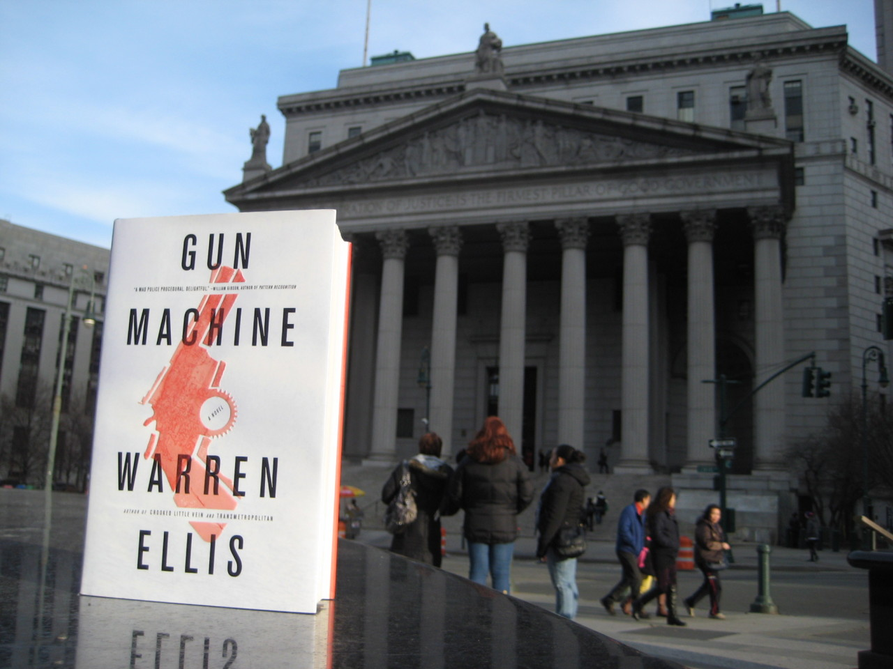 Drop #2: where in Manhattan is Gun Machine?Again, there are two ways to get your hands on a copy of Gun Machine before it becomes available to everyone else: Either go to the location above and pick it up or be the first to email thisisgunmachine@gmail.com with the book's location. I'm afraid we're only accepting entries from the US and UK. EDIT: We have a winner! The book is sitting in front of the New York county courthouse in downtown Manhattan.