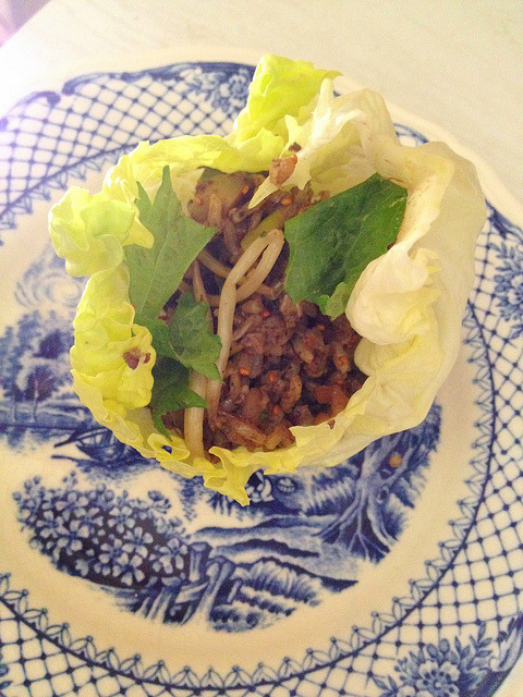 Homecooked Beef Sang Choi Bao with Vietnamese flavours - some one handed cooking thanks to my Magimix.  I simply blitzed the raw filling for these filled lettuce cups in the food processor.  In went 100g Warialda Beef Scotch Chain, 4 small fresh shitake, 2 garlic chives, half an onion, a small piece of bacon fat, a handful of homegrown Vietnamese mint and 5 water chestnuts.  Then I fried the mix with enoki mushrooms, Kampot pepper, Xiaoshing wine, soy sauce and oyster sauce to taste.  Next went in leftover steamed rice and beanshoots. It was finished with Vietnamese fish sauce and Greenvale Farm camelina seeds.  Garnished with perilla plucked straight from the garden it was light, fresh and painless on my sore paw.