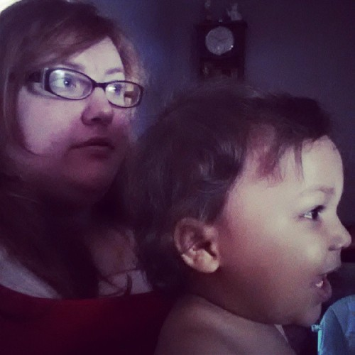 Nephew and aunt watching bubble guppies.