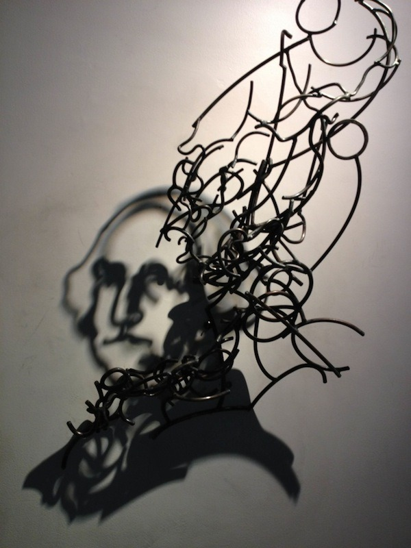 cjwho:  Incredible Shadow Art Created Out Of Messy Steel Wires by Larry Kagan  New York-based sculptor Larry Kagan crafts incredible shadow imagery out of mangled steel wires and light. With tiny gaps in between the wires, as spaces for light to shine through, he produces almost-detailed silhouettes with the help of the intangible medium.