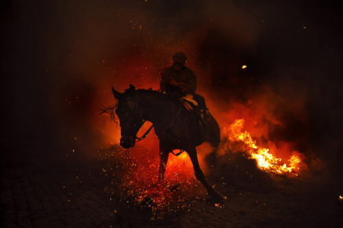 Daniel Ochoa de Olza—AP  Jan. 16, 2013. A man rides a horse through a bonfire in San Bartolome de Pinares, Spain. Read more: http://lightbox.time.com/2013/01/18/pictures-of-the-week-january-11-january-18/#ixzz2IMVjZMUt