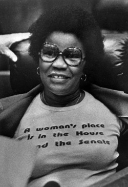 "auntada:  Representative Carrie Meek's shirt reads: ""A women's place is in the House and the Senate.""  Carrie Meek  (b.  April 29, 1926) wore this prophetic T-shirt in the Florida House chamber in 1980, where she served from 1978 to 1983. In 1982, she became the first African-American woman elected to the Florida Senate. Meek later served in the United States Congress (1992-2001). Prior to her career in politics, she taught at Bethune-Cookman College in Daytona Beach and Florida A&M University in Tallahassee. Meek's son, Kendrick Meek (b. September 6, 1966), was the U.S. Representative for Florida's 17th congressional district from 2003 to 2011. He was the Democratic nominee in the 2010 Senate election for the seat of Mel Martinez, but he and Independent Charlie Crist lost in a three-way race to Republican Marco Rubio. Source: State Library and Archives of Florida"
