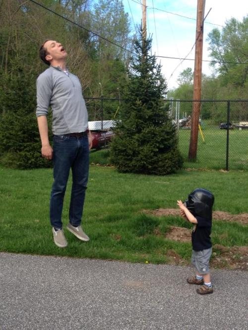 laughingsquid:  Photo of a Little Kid in a Darth Vader Helmet 'Vadering' a Grown Man
