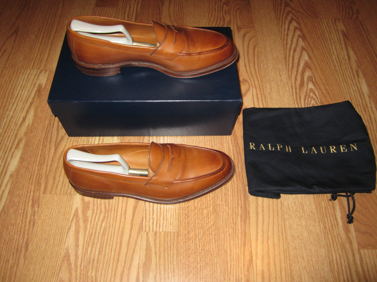 "putthison:  Searching for Ralph Lauren Shoes on eBay Ian from the blog From Squalor to Baller has been writing a pretty good series on how to build a basic business casual wardrobe. His latest entry on footwear reminded me of something: Ralph Lauren shoes on eBay are one of the best ways a man can buy decent-quality, classic shoes for not too much money.  To be sure, Ralph Lauren makes a lot of crap (sorry, Ralph). His company basically sells things at every price point on the spectrum, and the lower end stuff isn't terribly worth buying. But that's also maybe why Ralph Lauren shoes don't go for much money on eBay. Most people don't want to sift through the chaff. If you're willing to, however, you can find some great deals. For example, see the following auctions that just ended: Basic brown bluchers for $90 Suede chukkas for $125 Suede chukkas again for $100 Quarter brogues for $125 Pebble grained boots for $125 Suede semi brogues for $100 Penny loafers for $62 Burnished loafers for $113 If you look hard enough, and are patient, you can score some decent shoes for $125 and under. The problem is obviously trying to figure out what's worth buying. Unfortunately, it can be difficult to discern the true quality of things from just a photo on eBay (sometimes a bad photo at that). There are some things you can do, however.  First, use a more refined search link. Ralph Lauren generally makes terrible sneakers and tennis shoes, so you can exclude those from your search by keying in ""-tennis, -sneakers, -sneaker"" to your query (minus the quotation marks). These will take out the words ""tennis,"" ""sneakers,"" and ""sneaker"" from your search. You probably also want to take out anything from the Chaps line, and exclude RLX shoes (as those won't be in the classic styles you're presumably interested in). So add ""-Chaps, -RLX"" to the end as well. Here is a link to the search with all these conditions, which you can use to find shoes in your size. Feel free to amend the query with even more parameters as you see fit.  Second, while I hate to encourage people to think about a garment's quality in terms of its country of origin (which is often not a very reliable way to determine quality, by the way), it's generally true in this case that RL's shoes made in England and Italy will be of higher quality than those made in Asian countries. So, if you can, look for a photo that shows a label declaring where the shoes have been produced. If you don't see one, ask the seller. Or, better yet, you can do an advanced search and add ""(England, Italy)"" to your query (again, without the quotation marks). Then tick the box for ""Search Titles and Descriptions."" This will pull up any auctions that have the words England or Italy in them. (Note, this will also pull up any auctions that have used the words Ralph Lauren, but are not actual Ralph Lauren shoes, so be careful).  Third, while it's not always true that more expensive things will be better made than less expensive things, it's generally true here. If you see a manufacturer suggested retail price (MSRP) of $350+ or so, it's not a bad bet that the shoes have been decently made.  Fourth, avoid shoes with overt branding. That is, shoes with pony logos, the word ""Polo,"" or the name ""Ralph Lauren."" It's fine if these are on the bottom of the sole or the inside of the shoes, but anything on the uppers is generally a mark that it comes from a lower-quality line. Finally, as a general rule, try to go for shoes with hard bottom leather soles. Shoes with rubber soles or even half rubber soles (like this) are more likely to be of poor quality. There are exceptions, of course. Suede bucks and boat shoes will almost always come with rubber soles, so this won't be an indicator of anything. Use smart judgement.  Again, there are a lot of ugly and poorly made Ralph Lauren shoes on eBay, but with some smart searching and a lot of patience, you can find decent shoes on eBay for less than what you'd pay for if you were hunting for Crockett & Jones or Allen Edmonds. Many of those companies are the ones producing for Ralph Lauren anyway; you're just getting a different logo on the inside of the shoes."