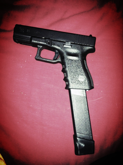 Here is another pic of my Glock 23 with extended mag