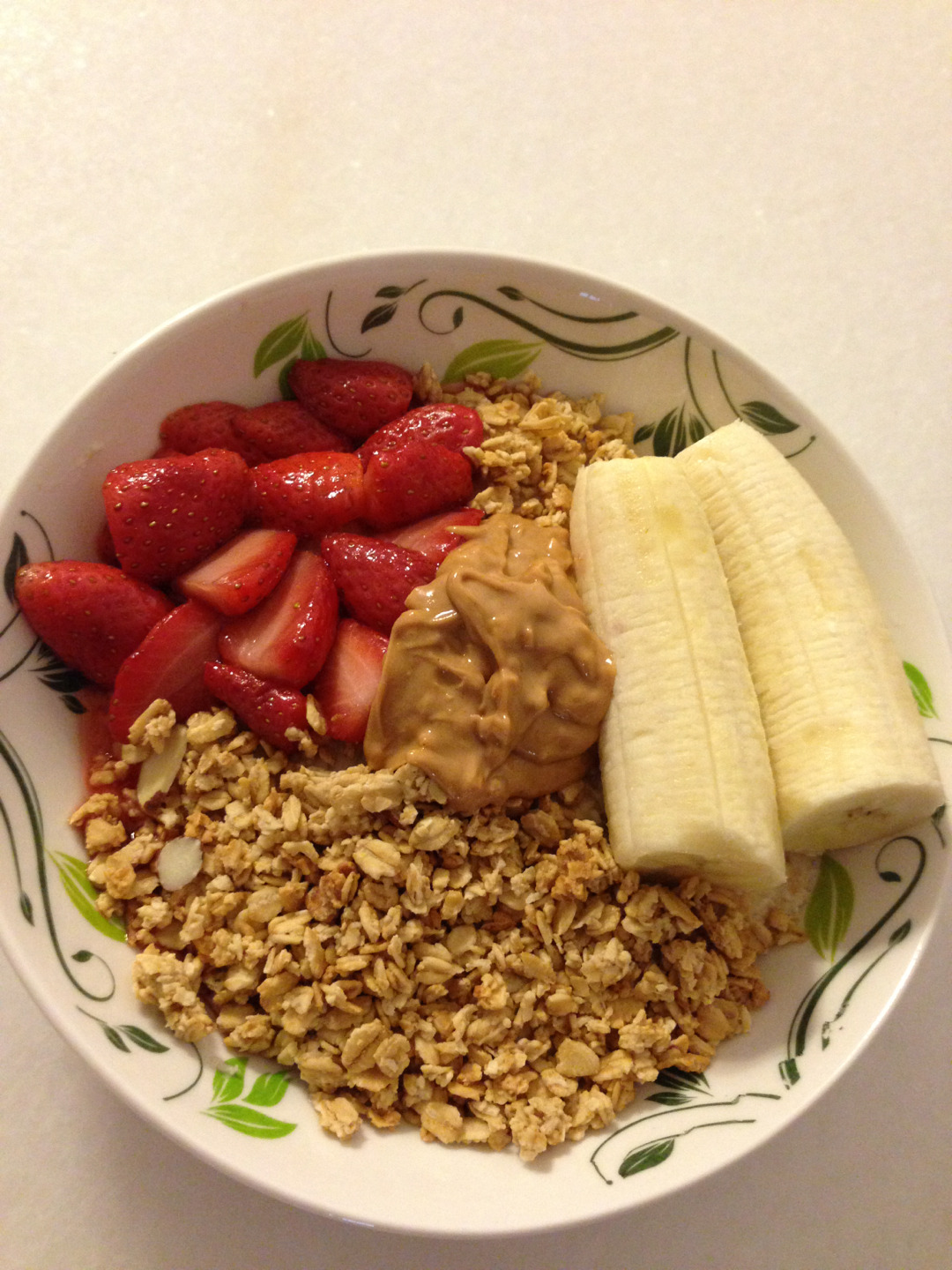Oatmeal constituting warmed strawberries, banana, honey nut crunch granola and melted peanut butter. :) Yummmm <3