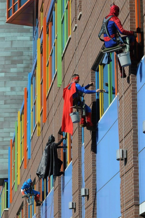 harrehcum: These men are window washers at a children's hospital in Pittsburg. Some might think the job is menial, but to the kids who are horribly ill, looking out their window seeing their favorite superhero at their window makes all the pain go away for a bit. And that would make the job worthwhile.