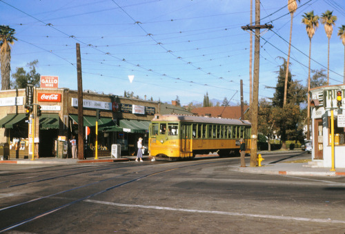 losangelespast:  Beautiful color still of a Los Angeles Transit Line trolley picking up a passenger on Monte Vista at Avenue 50, Highland Park, 1954. Barney's Liquor is still there.