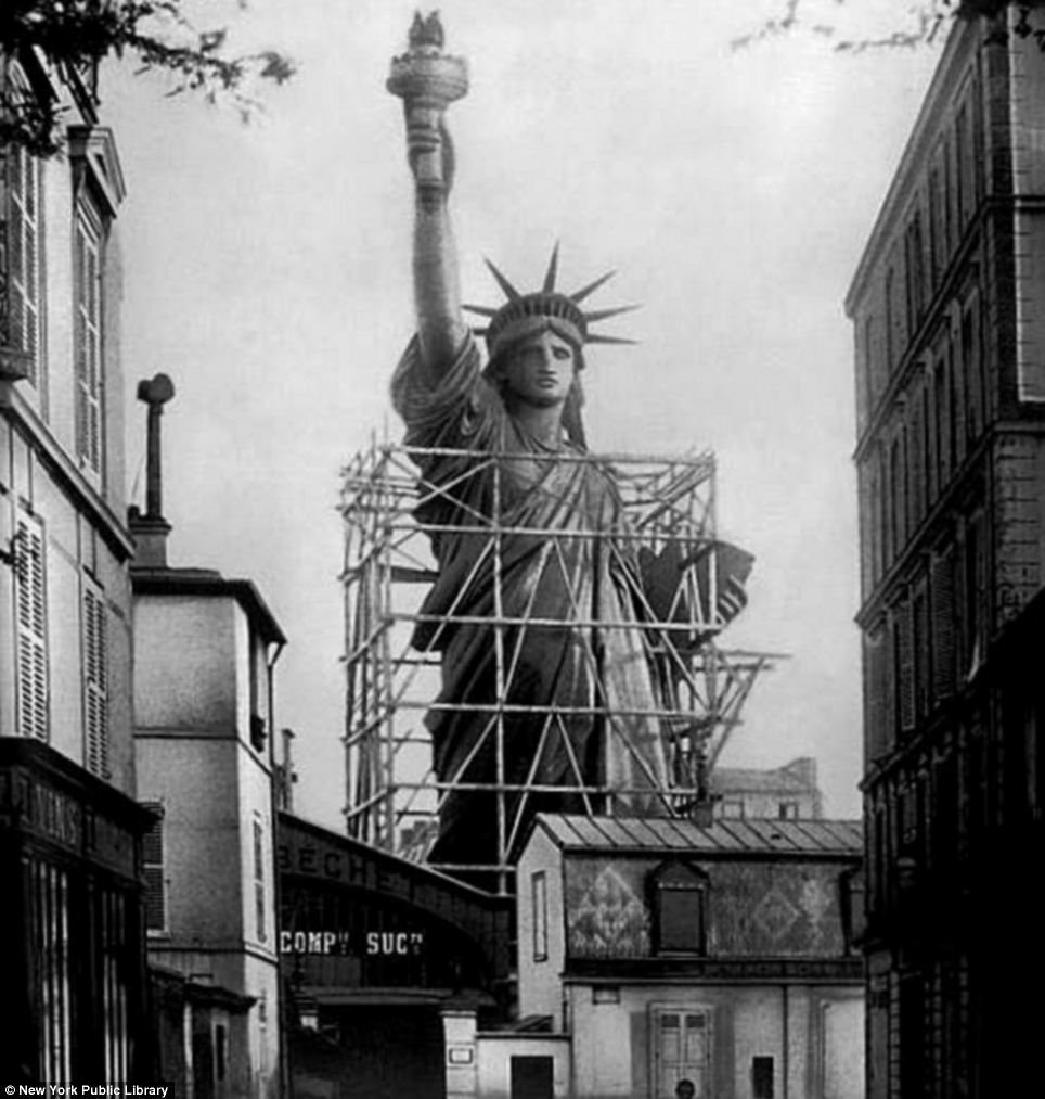 autoentropy:  The statue of Liberty surrounded by scaffolding as workers complete the final stages in Paris c. 1885.