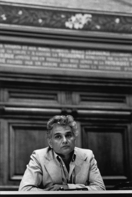 """At the age of twenty, Jacques Derrida took the entrance exams for the prestigious École Normale Supérieure a second time, having failed, as many students do, in his first attempt the previous year. Fueled by amphetamines after a sleepless week, he choked on the written portion and turned in a blank sheet of paper.""  Emily Eakin reviews a new biography that traces Derrida's lifelong sense of exclusion and his complicated relation to first French and then American academics.  Photo: Jacques Derrida at the Sorbonne, June, 1979 (Martine Franck/Magnum Photos)"