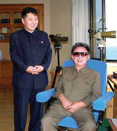 naenara:  Kim Jong Il and Kim Jong Un attending a military exercise  the revolutionary tradition will be continued from generation to generation!