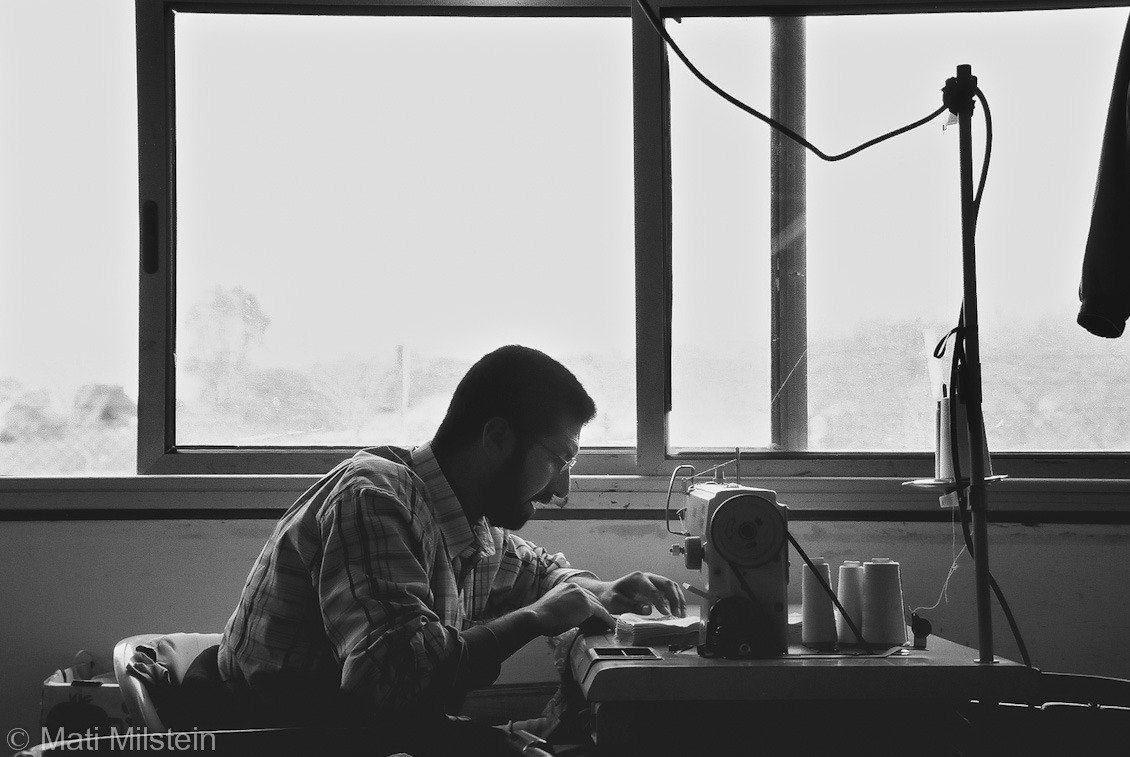Gaza, a retrospective (I)  A Palestinian man from Rafah works in a sewing factory in the Israeli settlement of Rafiah Yam in the southern Gaza Strip in 2005.