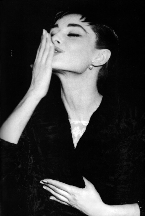 theniftyfifties:  Audrey Hepburn blows a kiss.
