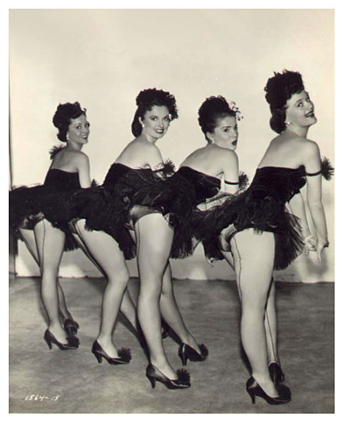 Vintage 50's-era photograph features a quartet of showgirls posing Backstage, at an unidentified nightclub or theatre..