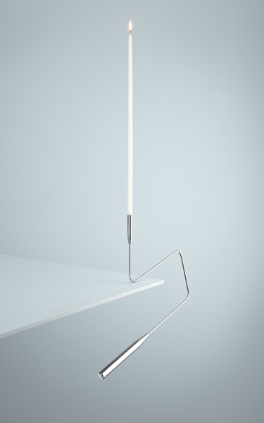 """Poise"" is a counterweighted candlestick designed to balance over a shelf or table edge. A contemporary twist on a traditional object."