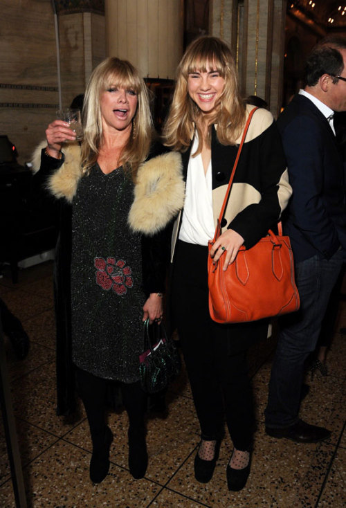 "Jo Wood and Suki Waterhouse  ""It's official. We are all totally, totally, Great Gatsby crazy. Last night we attended an amazing themed party at the Criterion in Picadilly before popping over to the fabulous Haymarket cinema for a special screening of the film itself hosted by Warner Brothers and Tiffany & Co. The film fans of you will know The lovely Suki Waterhouse was also there in a Kate Spade coat and towering heels, she told us, 'If I wear heels they have to be platforms, thinner heels just end up hurting my feet too much.' We know what you mean Suki!"""
