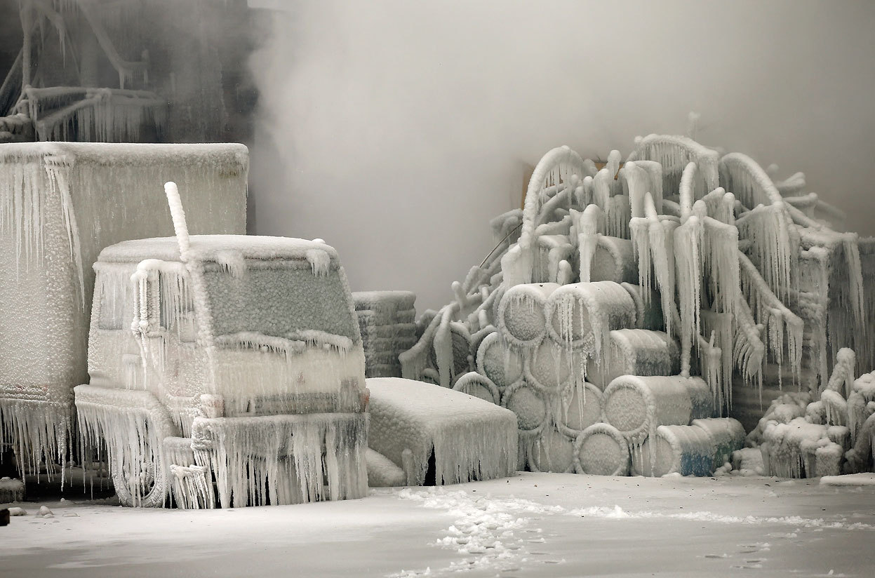 atlanticinfocus:  From Chicago's Freezing Fire, one of 16 photos. A truck is covered in ice as firefighters work to extinguish a massive blaze at a vacant warehouse in Chicago, Illinois, on January 23, 2013. More than 200 firefighters battled the five-alarm fire as temperatures were in the single digits. (Scott Olson/Getty Images)