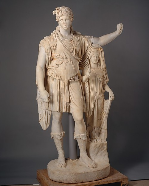 Marble statue of the god Dionysos This statue has been extensively repaired in the 18th century but also in ancient times, it's head is ancient but orginally belonged to another statue. It is, as many roman statues, a copy of a greek statue. The god dionysos is the god of wine and divine intoxication.  Roman Early roman empire, 27 BC - 68 AD, emperor Augustan or Julio-Claudian Source: The Metropolitan Museum