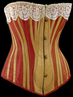 "omgthatdress:  Corset 1883 The Victoria & Albert Museum ""In the early 1870s, as the crinoline was replaced by the bustle, corsets changed shape. In order to achieve the fashionable slender silhouette, they became much longer. Corsets also had to be rigid to conceal the layers of underwear, including the chemise and petticoat, which were worn beneath. This corset is cut from separate pieces and reinforced with leather. Strips of covered whalebone form the scaffolding of the corset. Whalebone is strong yet flexible and therefore ideal for moulding the body of the corset and its wearer. It created a cage around the torso, enclosing the upper body and accentuating the bust and hips. The steel busk defined the front of the garment. On this corset the spoon-shaped busk is wider at the bottom than the top. This was supposed to equalise pressure on the abdomen, making the corset more wearable. In reality, it could make it more restricting as the corset could be pulled in more at the waist."""