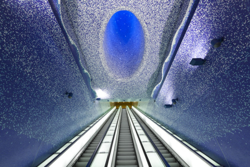 "Toledo Metro Station by Oscar Tusquets Blanca Voted ""The most impressive underground railway station in Europe"" by the Daily Telegraph, this immense train station has every surface transformed by a blue sea of bisazza mosaics with a portal to the sky above. This is part of a larger project to transform the metro system in Napoli with large scale art installations created by an array of artists.       Artists: 