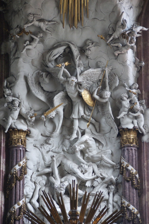 signorcasaubon:  Detail: The Reredos of the High Altar of Michaelkirche (Saint Michael's Church), in Vienna's historic Innere Stadt, showing the Taxiarch trampling down the fallen angels into Hell.   OMG Could this be the real life version of Pillar Men? :0