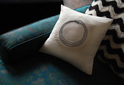 Hand Embroidered Black and Gold Ouroboros Pillow by SomeRabbits.