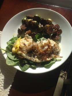 Late lunch: Spinach topped with sunny side up eggs & sautéed onions, roasted brussels sprouts