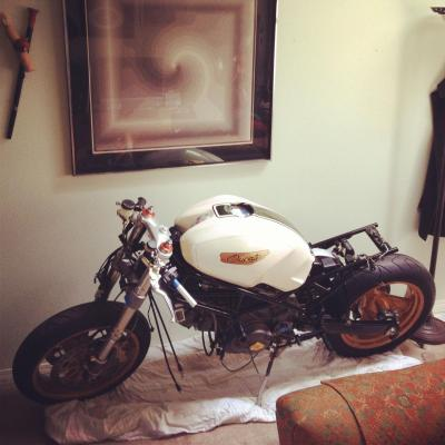 Doing some redecorating at my place. Monster Project mini update: The bike is back at home (obviously) while Heath finishes moving his shop so we can start on the exhaust and then the seat will be finished.  We're getting closer…  [ see more photos of motorcycles parked indoors ]