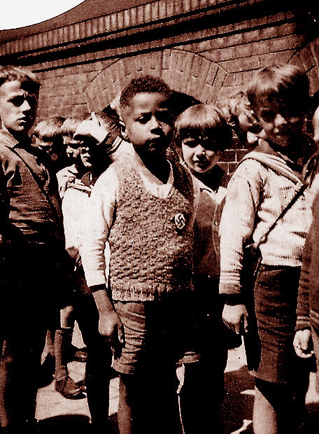 "obitoftheday:   Obit of the Day: ""Growing Up Black in Nazi Germany"" Hans Massaquoi was very disappointed when his teacher told him that he could not join the Hitler Youth. Massaquoi's friends had all joined and he was enthralled with the uniforms, the parades, the camp-outs. But Hans' desire to join was trumped by the color of his skin. Born in 1926, Mr. Massaquoi's parents were a German nurse and the son of a Liberian diplomat. He would grow up in Hamburg as the Weimar Republic was collapsing and the the Third Reich was building up. When he was in second grade, Mr. Massaquoi was so taken with the Nazi imagery that, at his request, his nanny sewed a swastika to his sweater. Although his mother removed it when he returned home from school, a picture had already been taken. (See above.) Mr. Massaquoi's family lived in Germany for the duration of the war. According to Mr. Massaquoi's memoir, Destined to Witness, he theorized that there were so few blacks living in Germany that they were a low priority for extermination. Eventually he would move: first to his father's home country of Liberia and later to Chicago. In the United States, although trained in aviation mechanics, Mr. Massaquoi would become a writer for Jet magazine and eventual move to its sister publication, Ebony, where he became managing editor. Mr. Massaquoi, who passed away on January 19, 2013 on his 87th birthday, was encouraged to write down the story of his unusual childhood by his friend and author of Roots, Alex Haley. Sources: L.A. Times and Chicago Sun-Times (Image is from Mr. Massaqoui's collection and copyright of William Morrow Paperbacks via spiritosanto.wordpress.com)"