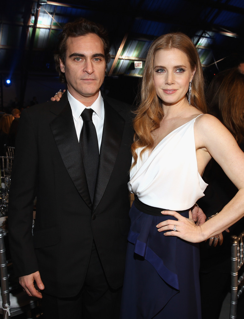 Joaquin Phoenix & Amy Adams - Critics' Choice Awards, January 10th 2013 Hooray! Awkquin is here to stun the award season with ill-fitting suits, uncomfortable expressions & hands hovering nervously over pretty lady's waists. I can't wait to see what crazy fun things he says on the red carpets to overexcited news media correspondents!