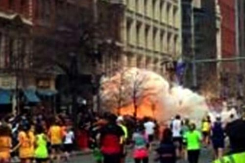 Reports of multiple devices found at the Boston Marathon explosion site. Get the latest updates here.  [Photo: WBZ TV, via AP]