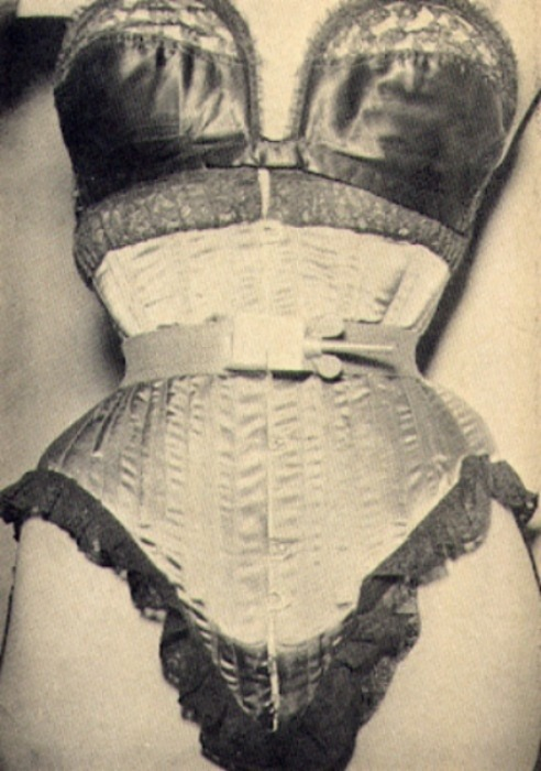 Corset with metal waist cinch, screw and wingnut from Exotique Magazine, c. 1950s