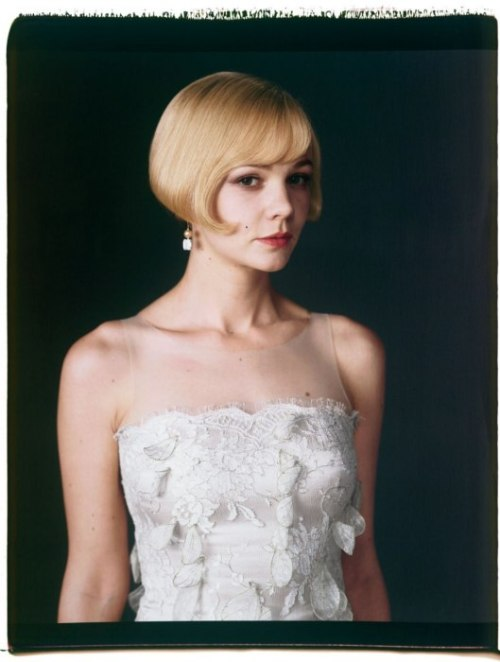 suicideblonde:  Carey Mulligan as Daisy Buchanan in The Great Gatsby photographed by Mary Ellen Mark