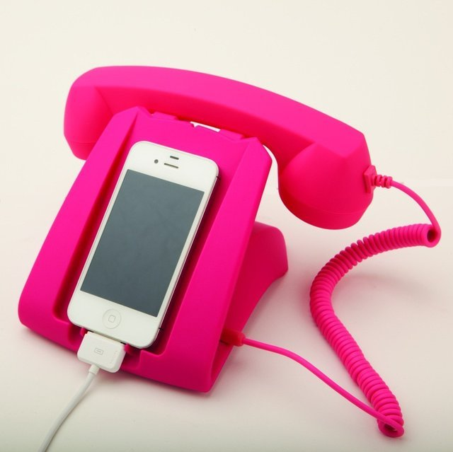 Pink Talk Dock  There's nothing retro about this talk dock - except it's adorable design! Plug in your cell phone to call up a friend or simply charge it.  Compatible with iPhone 4, iPhone 4S, iPhone 5, Blackberry and mobile phones equipped with 3.5mm jack. Can be used as charging stand or handset. No power needed.   (vía Fancy)