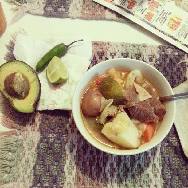 karlahoney:   My mami made some delicious #caldoderes♥ #food #mexicanfoodporn   LITERALLY what the table looks like when we eat… Paper napkin and grocery paper and all.