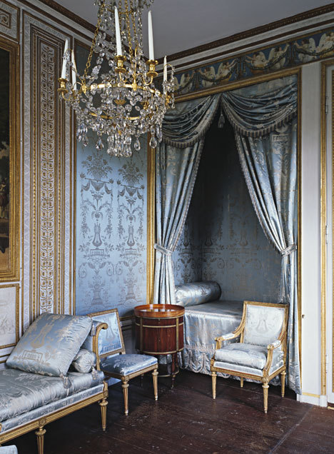 The bedroom in Gustav III's Pavilion at Haga, Sweden : Gustavian Classicism The Gustavian classicism dominated Swedish interior design from 1770  to circa 1810. This austere expression replaced the ornate Rococo, but during a short transition period, the two styles lived side by side. The bedroom in Gustav III's Pavilion at Haga (a small pleasure palace). Rococo came late to Sweden, in the 1750s, but then a new austere classical style had already began to develop  - particularly in France, where the interest in ancient Rome was very big. Gustav III was captured soon the classical currents, so did the foremost champions of the furniture and silver art. Already in the 1770s is a gentle tightening of furniture design. The forms became straighter and more symmetrical. After the king's trip to Italy 1783-1784 the interest in antiquity was immediately apparent. Now the ornaments and other decorations of ancient Rome - laurel wreaths, urns, medallions and classic borders became the height of fashion. Antique urns were everywhere, like framework with laurel wreaths. An elegant small border with beads on a row is often seen on chairs, mirrors and silverware.