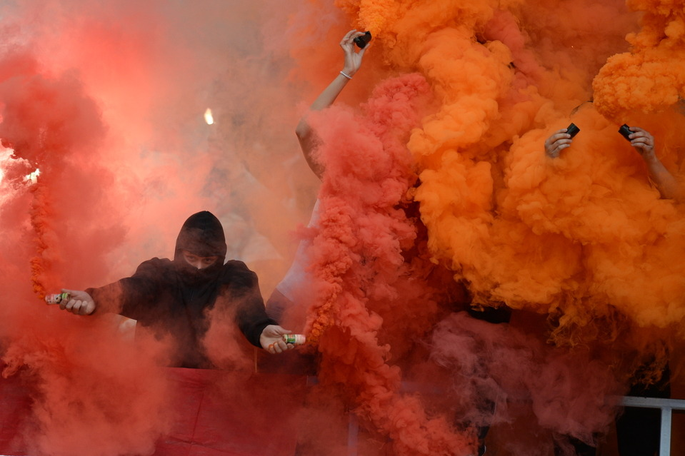 Spartak soccer fans set off smoke bombs at a Russian Premier League match between Spartak and Anzhi Makhachkala at Luzhniki Stadium in Moscow Sunday. Spartak won the game 2-0. Valery Sharifulin/ITAR-TASS/Zuma Press