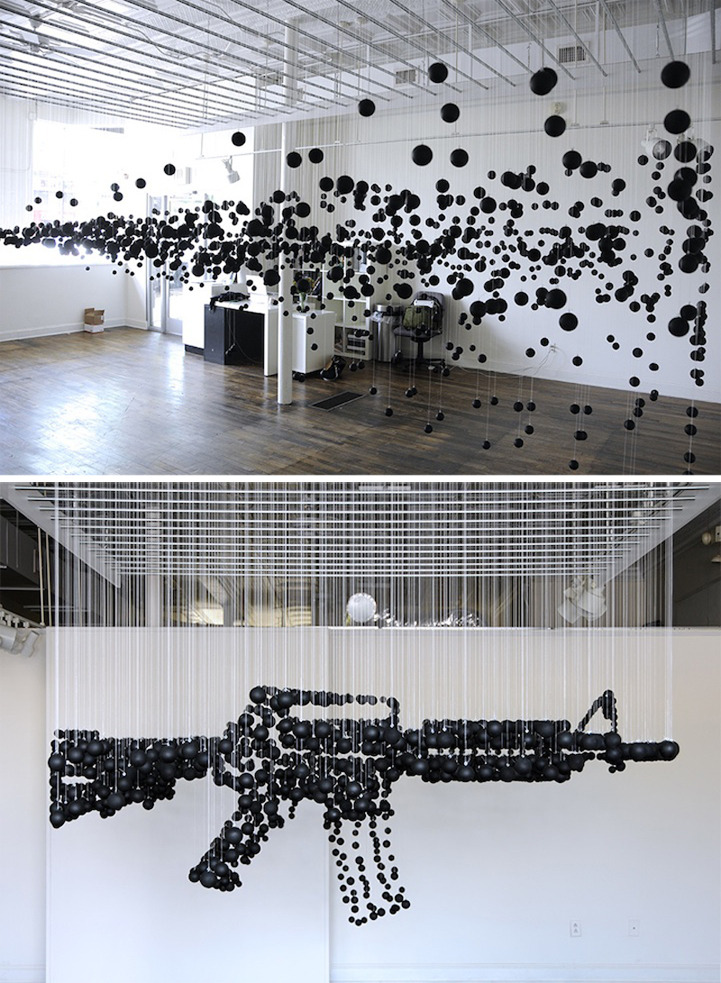 cjwho:  1200 Black Ping Pong Balls Form a Deadly Assault Rifle by Michael Murphy