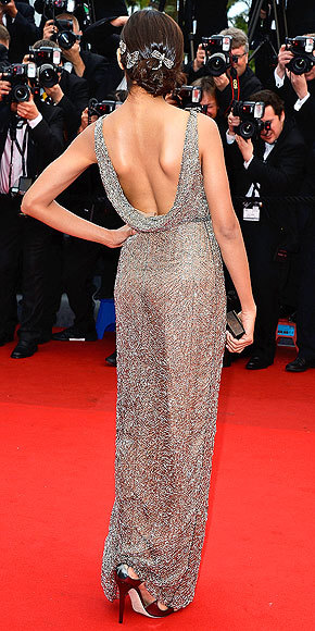 Better From The Back? Freida Pinto The front of this heavily-beaded metallic design features crystal dragonflies floating across the bodice (!) and a thigh-high slit, but the draped back is simple perfection.