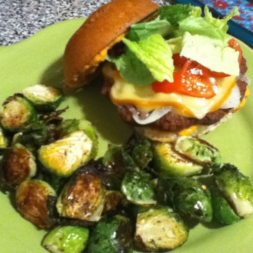 Veggie Boca burger with sautéed onions and Munster  cheese in a #glutenfree @udisglutenfree bun. With a side I'd crispy roasted Brussels sprouts. #notfried #grilled #yum #healthy #homecook